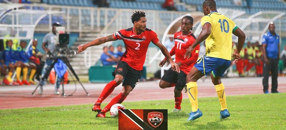 T&T's Alvin Jones, team mate Darren Mitchell and Barbados' Arantees Lawrence, during the international Friendly between Trinidad & Tobago and Barbados at the Ato Boldon Stadium, Couva. Photo: Matthew Lee Kong/CA-images