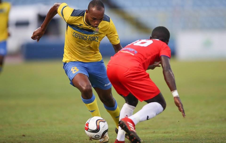 Photo: Defence Force FC forward Brent Sam attempts to drive past Morvant Caledonia United's Travell Edwards during their First Citizens Cup 2018 semi-final clash at the Hasely Crawford Stadium on Jul. 13, 2018. (Courtesy First Citizens/CAI/Allan V. Crane)