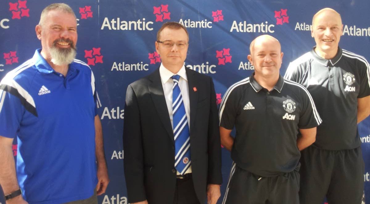 Former Manchester United footballer Brian McClair, left, Atlantic CEO Nigel Darlow, second from left, head coach of Manchester United Football Academy (MUFA) Eamon Mulvey, second from right, and MUFA coach Kevin Ward.