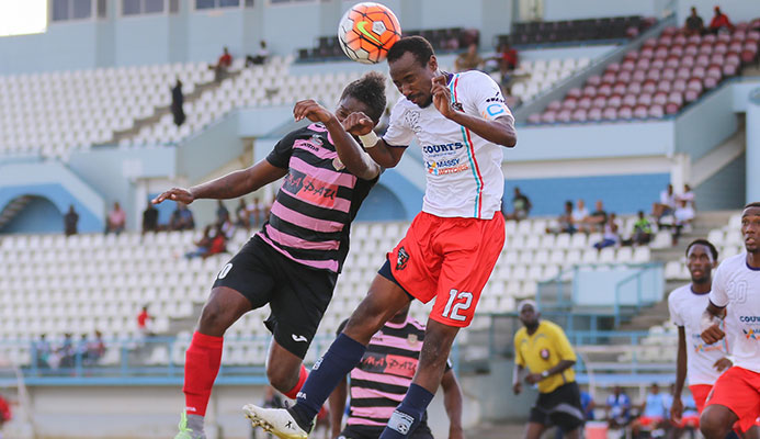 Morvant Caledonia United veteran full-back Kareem Joseph, right, vies for the ball with a North East Stars player during the 2016/17 Pro League season.