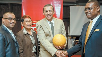 President Anthony Carmona, second from right, shakes hands with T&T Football Association president Raymond Tim Kee during the launch of the TTFA Youth Football Clinics and distribution 15,000 virtually indestructible footballs for primary schools across the country. With them are Lifestyle Motors senior manager Marlon Garib and the projectÂ's coordinator Mary Siu Butt. Photo courtesy TTFA media