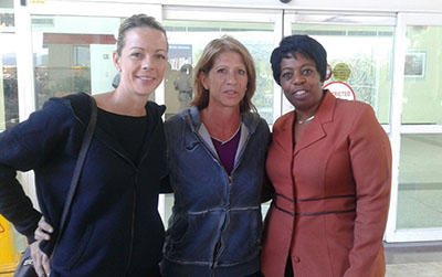Newly appointed national women's football coach Carolina Morrace, centre, at the Piarco International Airport on her arrival to T&T, yesterday afternoon. With her is assistant coach Nicola Williams, left, and Joanne Salazar, the third vice-president in the T&T Football Association (TTFA).