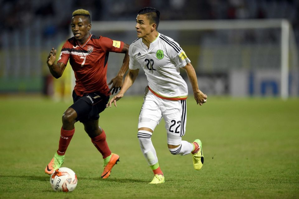 Trinidad and Tobago's forward Cordell Cato (L) and Mexico's Luis Reyes vie for the ball during their 2018 FIFA World Cup qualifier football match in Port of Spain, Trinidad & Tobago, on March 28, 2017. - (Credit: AFP/Getty Images / ALFREDO ESTRELLA)