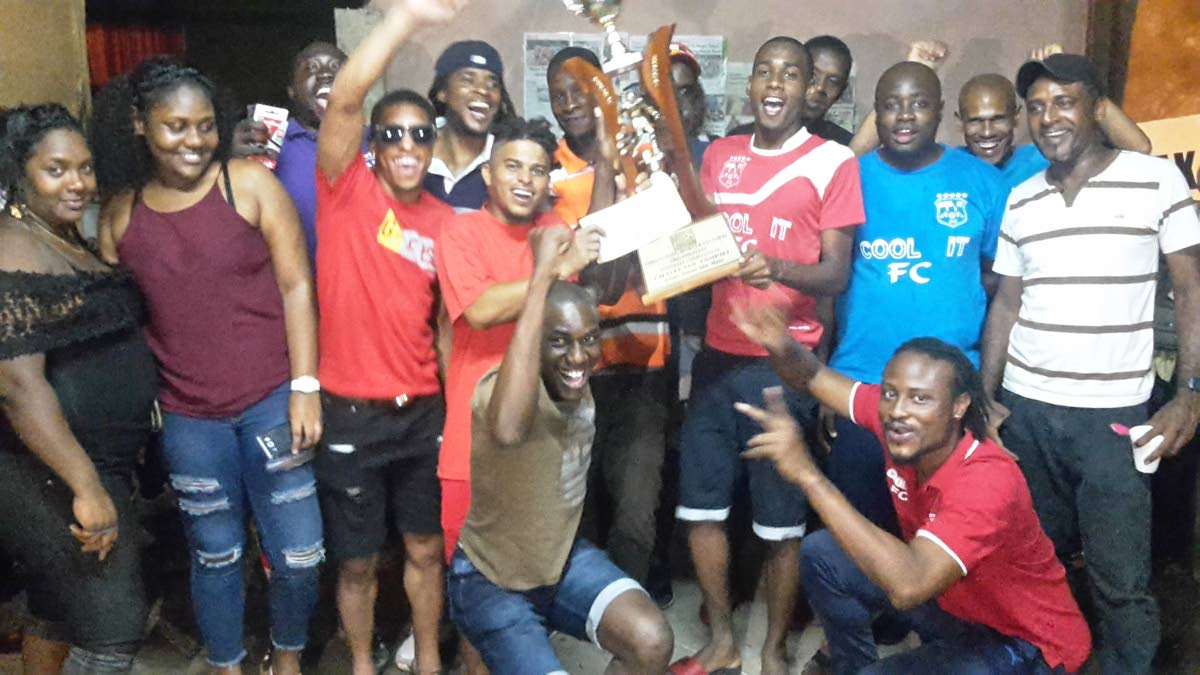 'Cool It' players and supporters celebrate their victory on Saturday in the Caribbean Welders Fishing Pond 'Big 8' competition.