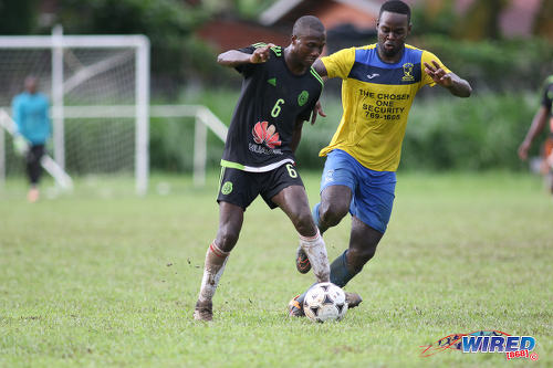 Photo: Petit Valley Diego Martin United playmaker Keron Cummings (left) tries to escape from a Central 500 Spartans opponent during TTSL Two action at the Diego Martin North Secondary ground on 15 July 2017 ...(Courtesy Chevaughn Christopher/Wired868)