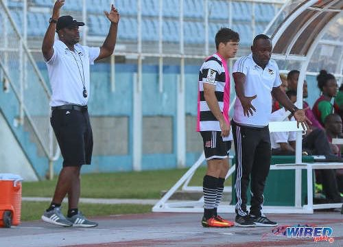 Photo: Central FC head coach Dale Saunders (right) gives instructions to substitute Sean De Silva (centre) while assistant coach Stern John gestures during Pro League action against San Juan Jabloteh at the Ato Boldon Stadium in Couva on 5 February 2017. ...(Courtesy Sean Morrison/Wired868)