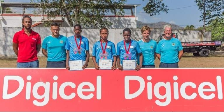 TOP THREE: The top three players who were selected from the clinic to represent Trinidad and Tobago, Trevis Byron, third from left, Judah Garcia, centre, and Jodel Brown, third from right. —Photo courtesy Digicel