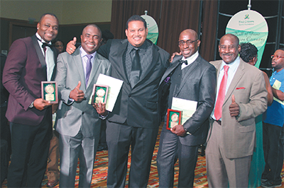 "Minister of Sport and Youth Affairs Darryl Smith, centre, shares the spotlight with the First Citizens Sports Foundation 2015 Hall of Fame inductees Stern John, left, Angus Eve, Clayton Morris and 1987 inductee Everald ""Gally"" Cummings. PHOTO: SEAN NERO"