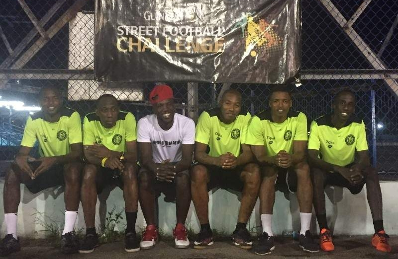 ZONAL CHAMPS: Kerry Joseph, second right, and Jerwyn Balthazar, right, pose with the other members of 2016 Guinness Street Football Challenge's South Zone champions Jr Mafia at the Skinner Park basketball court in San Fernando, last Saturday.