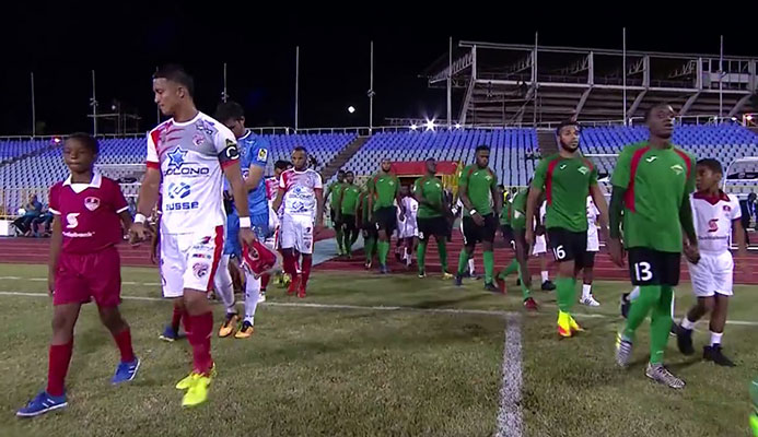 Photo: San Juan Jabloteh (green) and Santos de Guapiles ahead of kick off at the Hasely Crawford Stadium in Trinidad for their second leg clash of the Scotiabank CONCACAF League Round of 16 on Aug. 8, 2017.