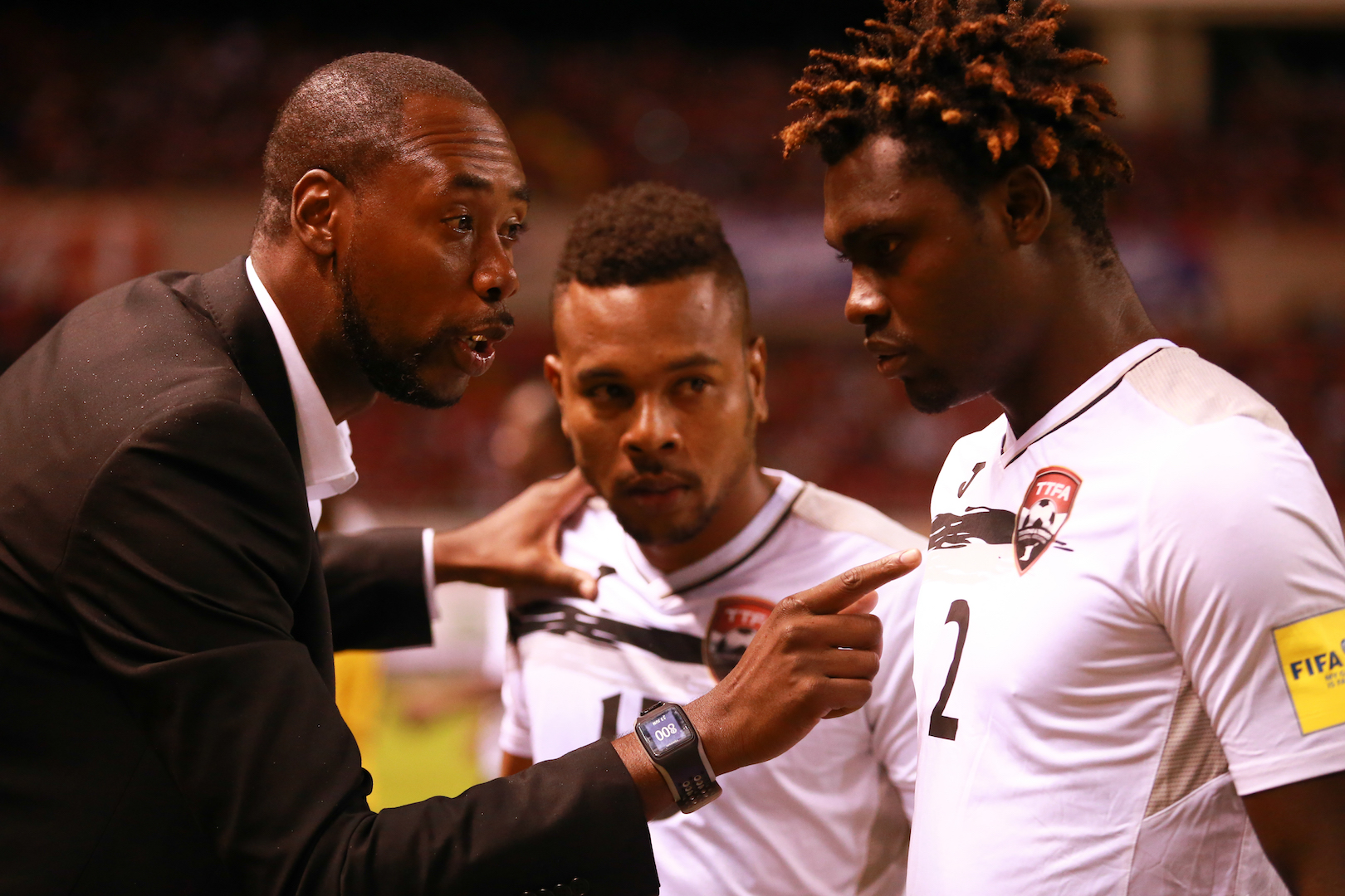 Headcoach Dennis Lawrence gives final instructions to defenders Aubery David (#2) and Curtis Gonzales ahead of the start of the FIFA Russia 2018 World Cup Qualifier match vs Costa Rica. Photo by Allan Crane (For editorial use, please contact Allan Crane)