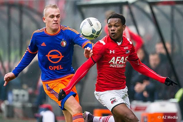 AZ Alkmaar's Levi Garcia is challenged for the ball during a Dutch Eredivisie match against Feyenoord Rotterdam at AFAS Stadion, Alkmaar, Netherlands on Sunday, January 24th 2016