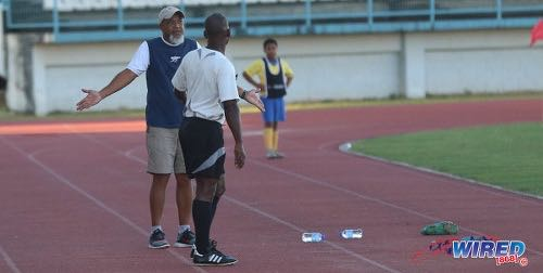 Photo: FC Santa Rosa head coach and TTSL president Keith Look Loy talks to fourth official Gordon Maloney during TTSL action against UTT at the Larry Gomes Stadium on 10 December 2017. (Courtesy Sean Morrison/Wired868)