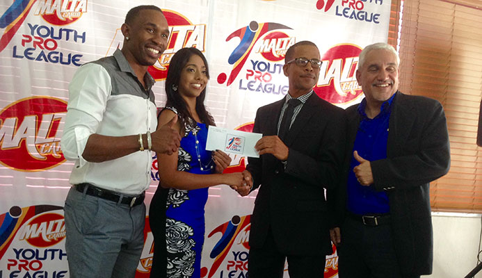 (Left to right) International cricket star Dwayne Bravo, Michelle Mungal, brand manager - soft drinks division - Malta Carib, TT Pro League CEO Dexter Skeene and Collin Murray, sponsorship and events manager at Malta Carib pictured during the launch of the Malta Carib Youth Pro League 2015 at the President's Box of the Queens Park Oval in Port of Spain on March 20, 2015.
