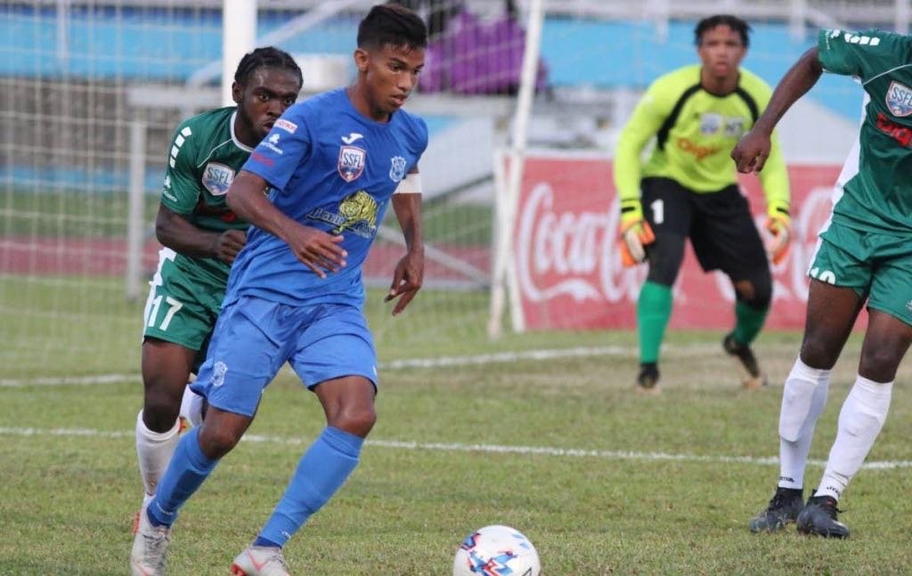 Naparima College's Mark Ramdeen controls the ball in the Coca-Cola National Intercol final, against San Juan North Secondary, at the Ato Boldon Stadium, Couva, yesterday.