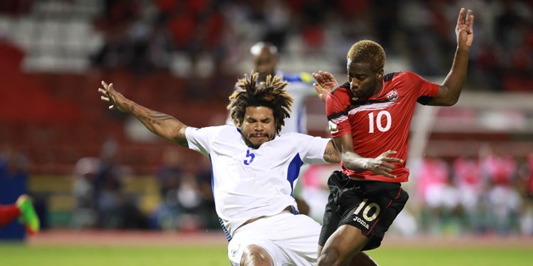 Trinidad & Tobago's Kevin Molino (#10) attempts a shot against visiting Panama in a World Cup qualifier on March 24, 2017, in Port of Spain. (Photo: CA-Images)