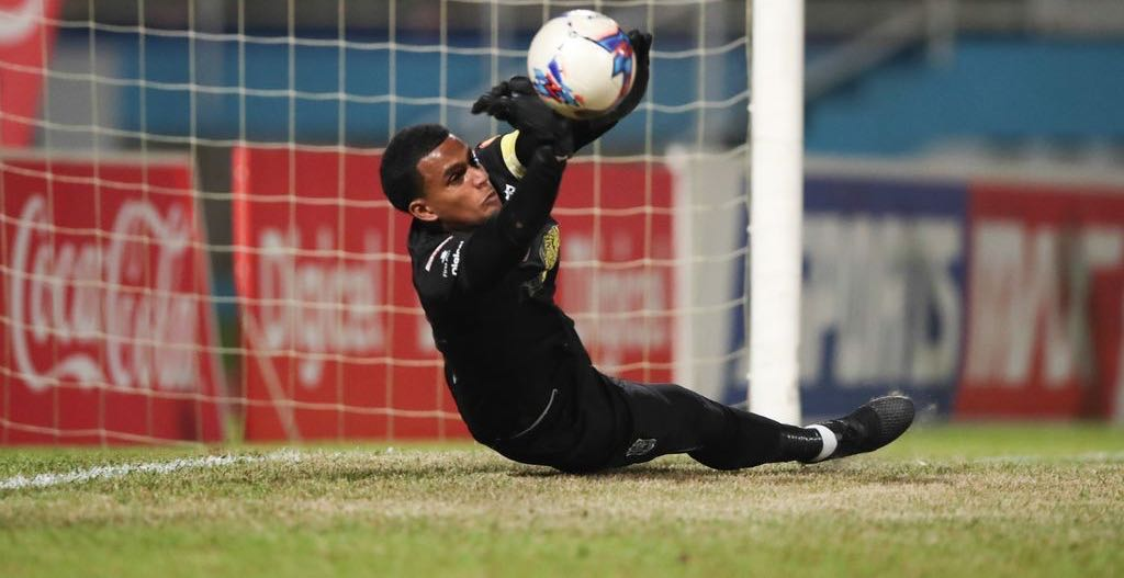 SAVE Naparima goalkeeper Levi Fernandez makes the first save in the sudden death penalty shoot out during the Coca-Cola Intercol National Boys' final between Naparima College and San Juan Secondary at the Ato Boldon Stadium, Couva, last evening. Naparima won 4-3 on penalties.