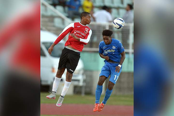 AERIAL BATTLE: St Anthony's Nkosi Salandy, left, heads the ball over Naparima College's Jarred Dass during the Secondary Schools Football League Coca Cola National InterCol final at the Manny Ramjohn Stadium, Marabella, yesterday. Dass scored twice as Naparima won 2-0. –Photo: DEXTER PHILIP