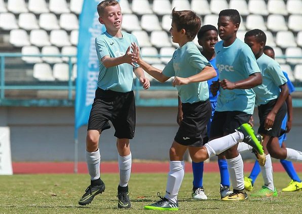 QPS players celebrate a goal during their match against a South Zone Under-12 team during the Republic Bank Youth Football League at Larry Gomes Stadium, Malabar, Arima. PICTURE MATTHEW LEE KONG