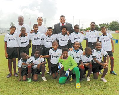 Minister of Sport and Youth Affairs Darryl Smith, back right, poses with the San Fernando Boys team.
