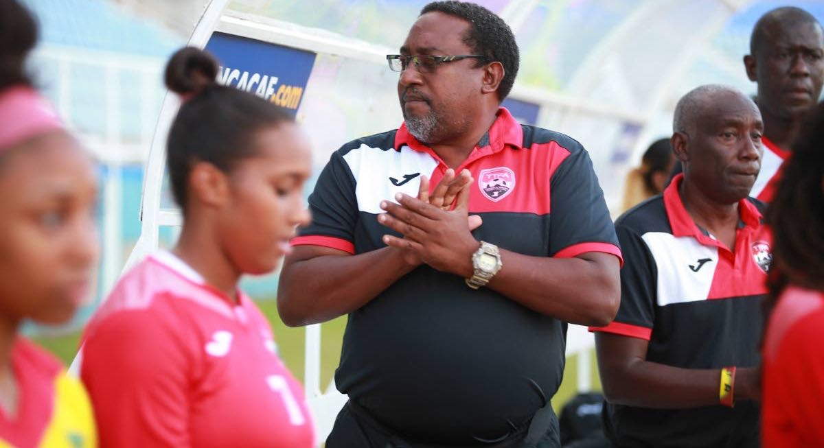 National women's football coach Jamaal Shabazz, centre, is keen to see this country be the premier force in the Caribbean again.