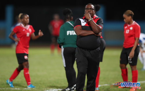 Photo: Trinidad and Tobago Women's National Senior Team coach Jamaal Shabazz (centre) considers his option during international friendly action against Panama at the Ato Boldon Stadium on 22 March, 2018. (Copyright Allan V Crane/CA-Images/Wired868)