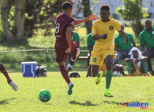 Photo: Signal Hill Secondary captain Akil Frank (right) slips the ball past East Mucurapo player Joshua Constantine during SSFL Premier Division action at Moka on 14 September 2016. ...(Courtesy Sean Morrison/Wired868)