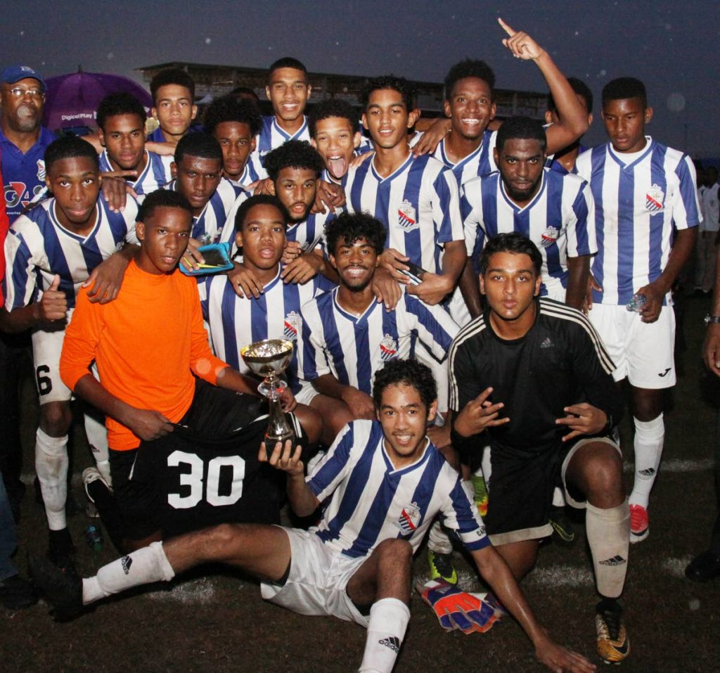 St Mary's footballers pose with the Coca Cola North Intercol trophy yesterday after beating St Anthony's 1-0 in the final at the Hasely Crawford Stadium, Mucurapo.