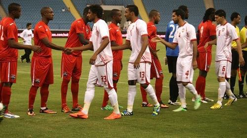 Flashback: Members of the Trinidad and Tobago and United Arab Emirates team meet each before the kick off in their 2013 encounter.