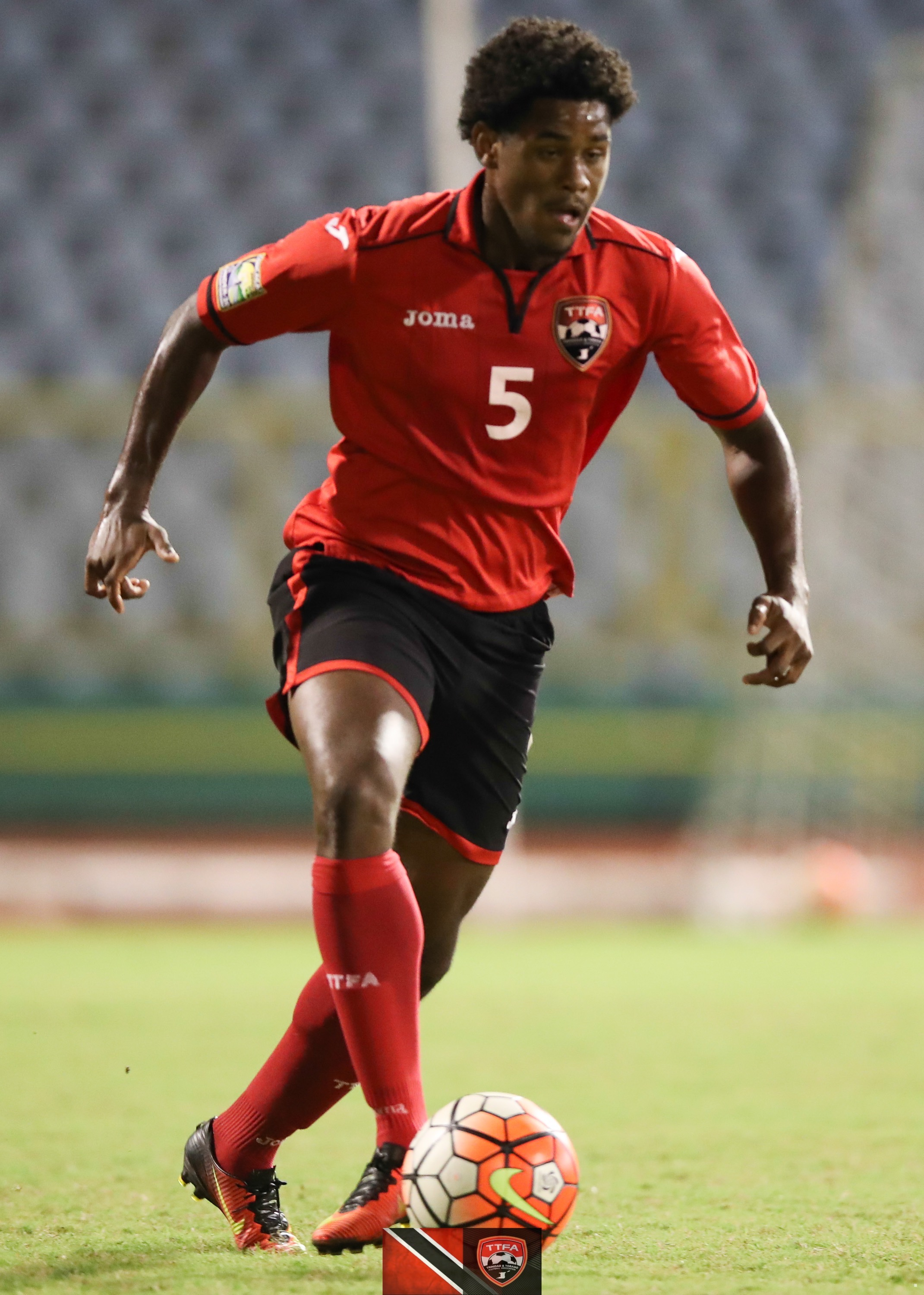 Ma Pau and T&T Under 20 defender Taryk Sampson.