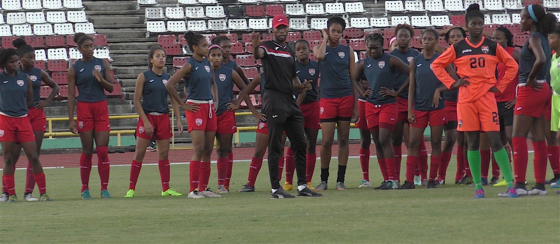 Photo caption – At top shows members of the Under 20 team during the warm up with trainer Saran Joseph at the Hasely Crawford Stadium on Tuesday. (Photo/TTFA Media)