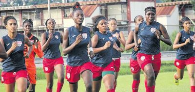 Brittney Williams, left, Demeisha Bailey, centre, Laurelle Theodore, right and Natisha John, far right lead the National U20 women's team through their paces during a practice session at the training grounds, Hasely Crawford Stadium.