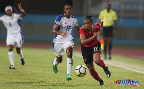Photo: Trinidad and Tobago forward Andrea Young (right) looks to peel away from Panama right-back Katherine Castillo during international friendly action at the Ato Boldon Stadium on 22 March, 2018. Panama won 2-1. ...(Copyright Chevaughn Christopher/Wired868)