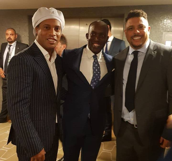 Dwight Yorke (centre) with legendary Brazil forwards Ronaldinho (left) and Ronaldo.