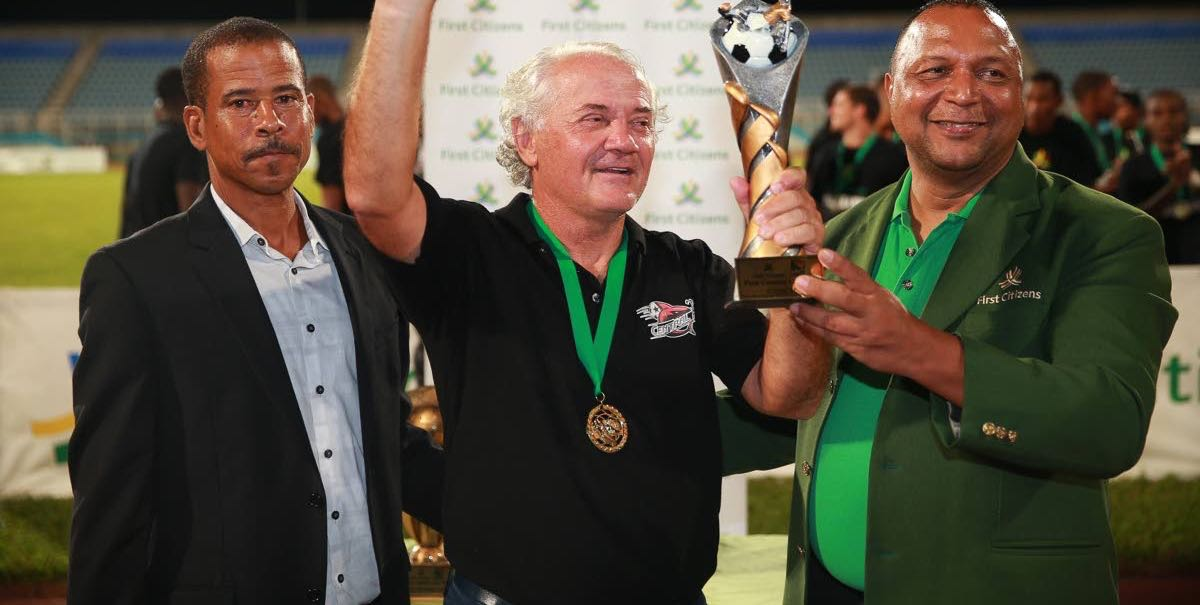 Zoran Vranes, centre, is presented with the 2014 First Citizens Cup Coach of the Tournament award from Warren Sookdar, First Citizens Chief Information Officer, right, and then TT Pro League CEO Dexter Skeene on Oct. 31, 2014 after leading Central FC to the title defence.
