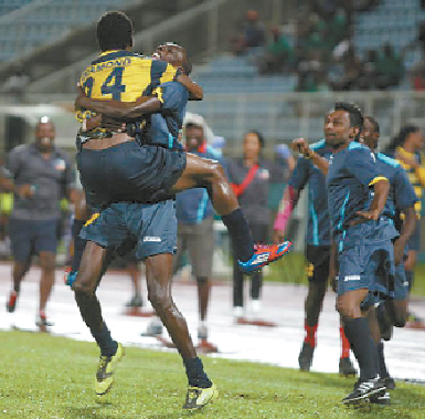 Club Sando midfielder Devon Modeste celebrates with a teammate after his match winning goal against Defence Force, in the semifinal of the Toyota Classic, at the Ato Boldon Stadium, Couva, on Saturday night. Photo: Anthony Harris