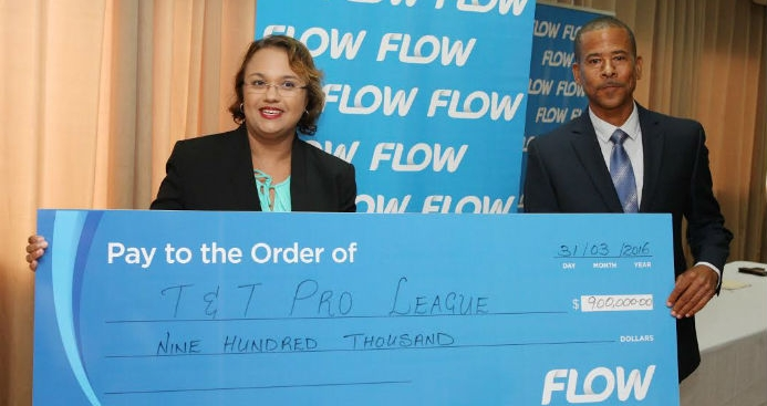 ​Flow Trinidad director of marketing Cindy Ann Gatt (left) presents TT Pro League CEO Dexter Skeene with a promotional cheque during the launch of a three-year partnership assigned to the Youth Pro League at the Hasely Crawford Stadium in Port-of-Spain on March 31, 2016.