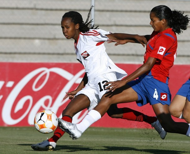 #12 Trinidad & Tobago striker Ahkeela Mollon (L) battles for the ball with Costa Rica's defender Karol Galvez during the first round in their CONCACAF Women's Olympic Qualification soccer match at the Benito Juarez stadium in Ciudad Juarez, April 4, 2008.