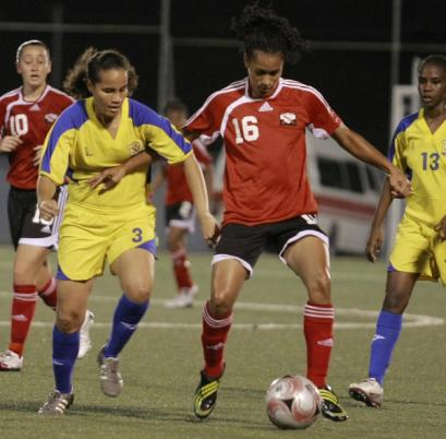 T&T's Avanelle Isaac, right, holds off Barbadian Gabrielle Lopez in their Caribbean Football Union Second Round Group F Women's Gold Cup/Central American and Caribbean Games (CAC) qualifiers at the Marvin Lee Stadium, Macoya on Wednesday night. T&T won 6-0. Photo: Anthony Harris
