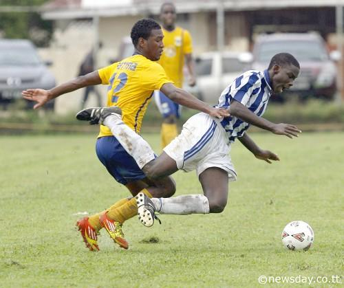FATIMA COLLEGE Jason Mendez challenges Rashad Hyacinth of St Mary's Collegeduring action at yesterday's Secondary School's Football League at Fatima College grounds. ...Author: Azlan Mohammed
