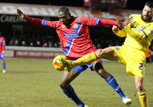 Daniel Carr of Dagenham & Redbridge battles with James Dunne of Portsmouth (pic: Dave Simpson/TGSPHOTO).