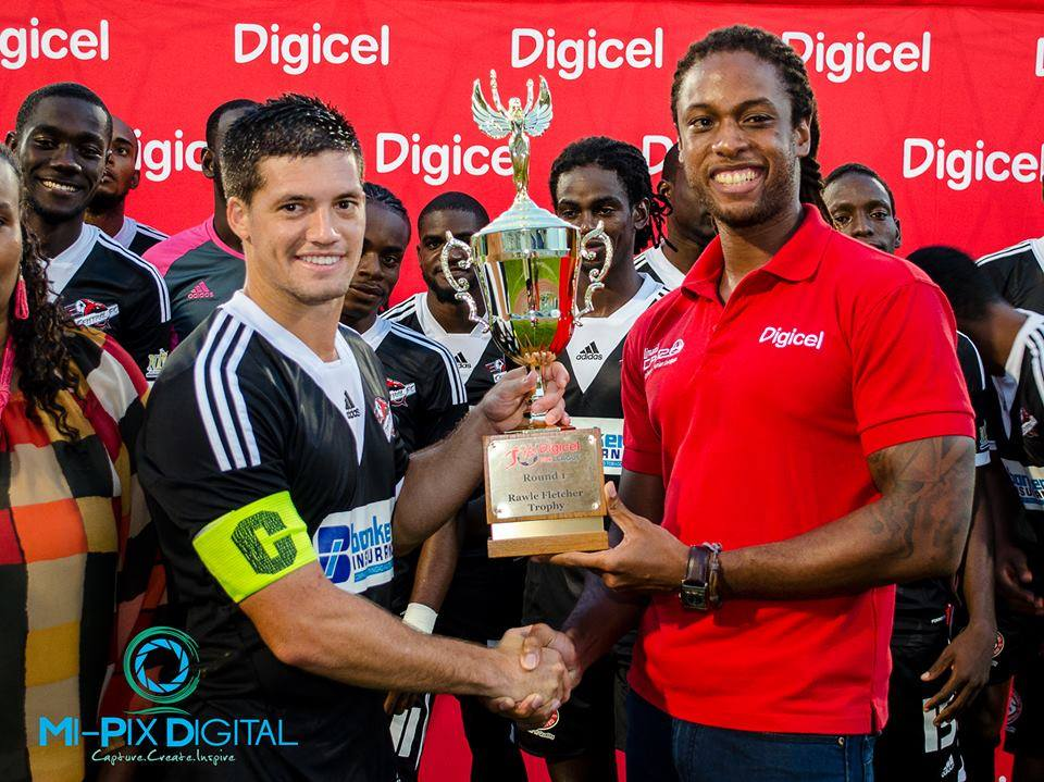 Central FC's vice captain, Sean De Silva, receives the Rawle Fletcher Trophy after the first round of the 2014/15 T&T Pro League season.