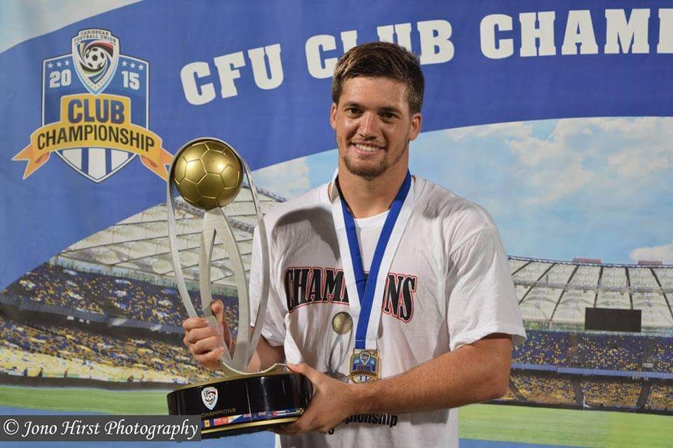 Sean de Silva with the 2015 CFU Club Championship Trophy