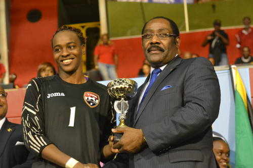 Kimika Forbes receives the Caribbean Cup Best Goalkeeper prize from Horace Burrell.