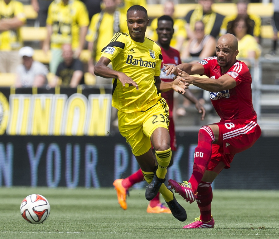 Jun 29, 2014; Columbus, OH, USA; FC Dallas midfielder Peter Luccin (8) battles for the ball wtih Columbus Crew defender Kevan George (23) at Crew Stadium. The game ended in a 0-0 tie. Credit: Greg Bartram-USA TODAY Sports