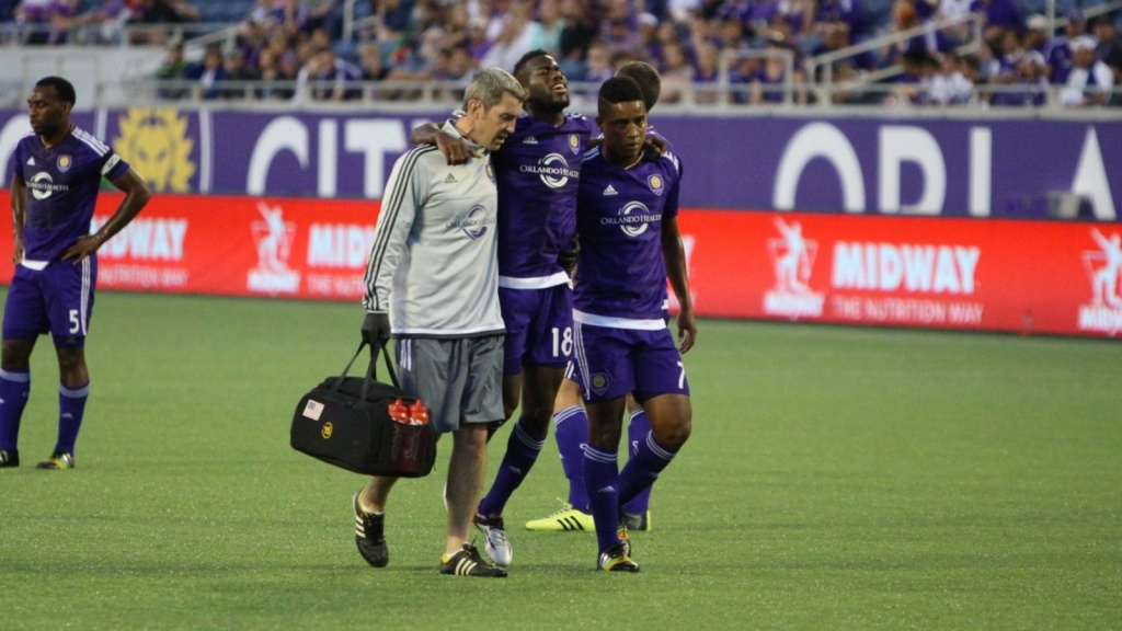Orlando City's Kevin Molino limps off the field after suffering a torn ACL in a friendly against Brazil's Ponte Preta.