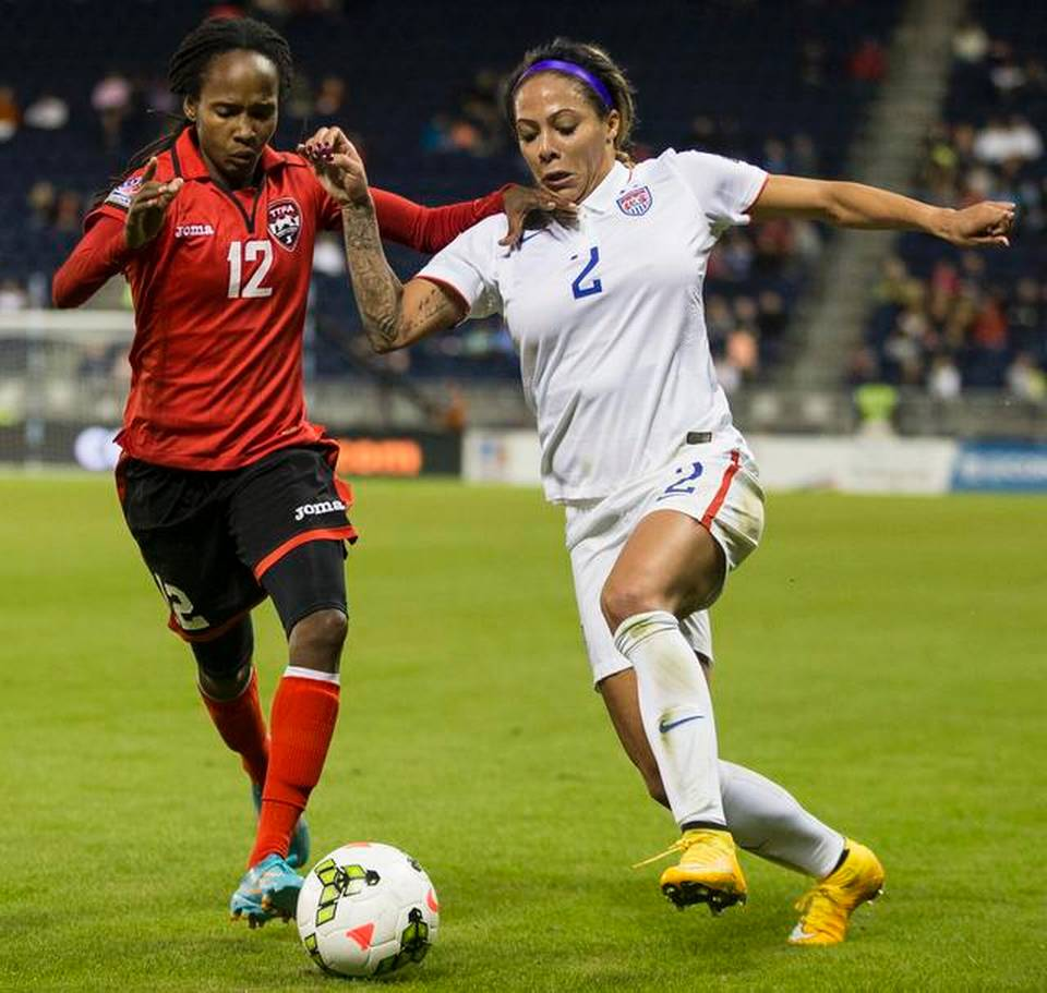 Sydney Leroux (2) of USA and Ahkeela Mollon (12) of Trinidad/Tobago compete for the ball during the CONCACAF Women's Championship at Sporting Park on Wednesday, October 15, 2014 in Kansas City, Kansas.