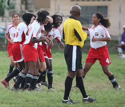 T&T women's Under-17 players celebrate a goal against Adams' Construction San Juan Jabloteh in the Lucky Bakery-sponsored National Women's Super League at the Barataria Oval, last month. The Under-17s won 3-1 and currently lead the standings. Photo: Anthony Harris.