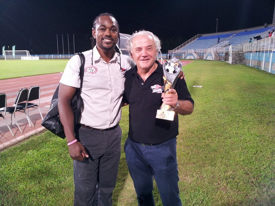 Central FC Managing Director Brent Sancho congratulates First Citizens Cup 2015 Best Coach Zoran Vranes on defending the trophy.