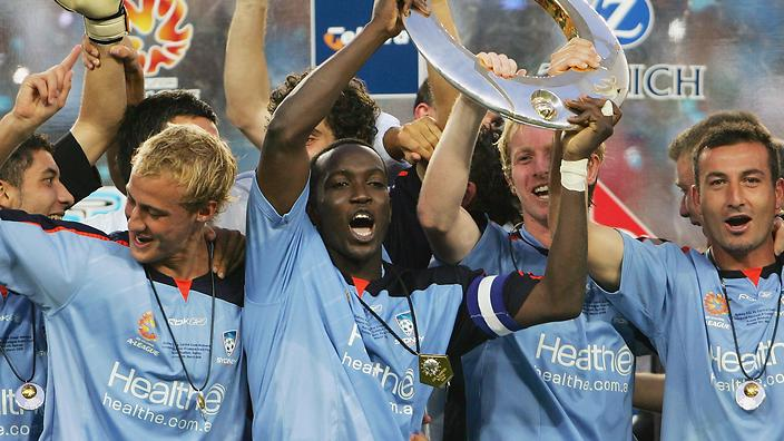 Dwight Yorke celebrates with Sydney FC teammates after winning the A-League championship